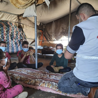 Doctors Without Borders educator Nader Owida conducts a COVID-19 health activity with children in Masafer Yatta, a collection of 19 Palestinian hamlets in the West Bank.