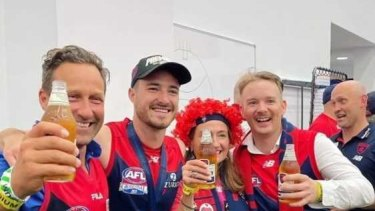 HaydenBurbank (left) and Mark Babbage (right) inside the AFL rooms after Melbourne's win at the Grand final.