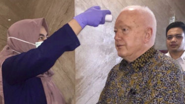 Australia's Ambassador to Indonesia Gary Quinlan undergoes a temperature check before meeting Indonesia's Foreign Minister Retno Marsudi, in Jakarta on March 9, 2020.