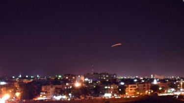 The Syrian state agency SANA released pictures of reported air defence systems intercepting missiles over Damascus on Saturday.