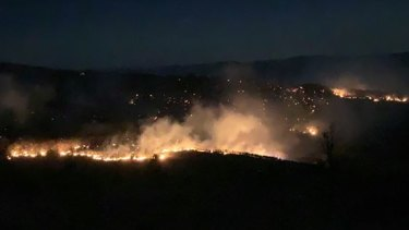 Rural Fire Service firefighter Julia Hopkins captures the glow of the Thornton bushfire in the Lockyer Valley.