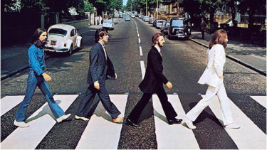 The iconic cover shot of the Abbey Road album, taken outside the titular London studio as the Beatles recorded there in 1969.