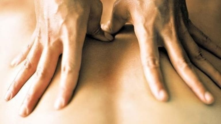 The massage parlour operator was penalised for not back-paying two of its employees.