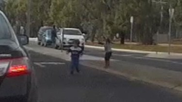 The children run onto the road.