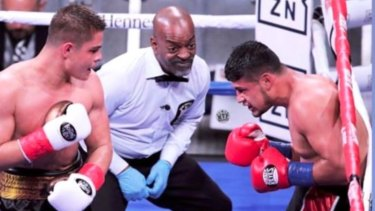 Rising star: Bilal Akkawy has Victor Fonseca on the ropes at Madison Square Garden last year.