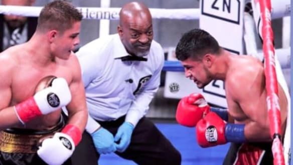Rising star: Bilal Akkawy unloads on Victor Fonseca at Madison Square Garden.
