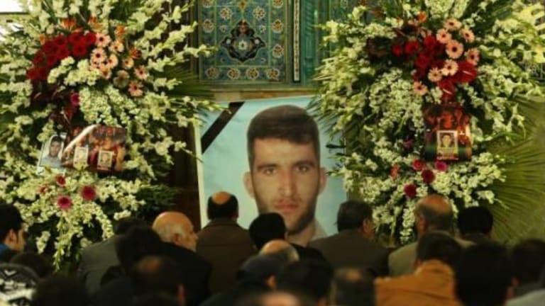 Relatives of Reza Barati, who was killed during a riot on Manus, mourn his death in Tehran in February 2014.