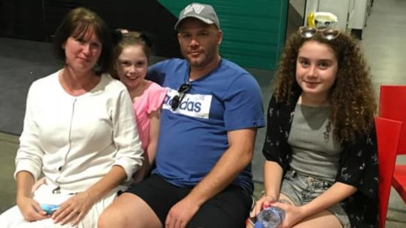 British tourists Fiona and Leon Senior and their daughters Lily and Grace were forced to evacuate the Opal Tower after an internal wall failed.