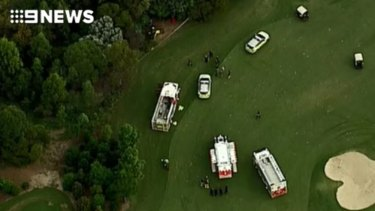 The man was trapped for about 30 minutes underneath the tractor at Indooroopilly Golf Club.