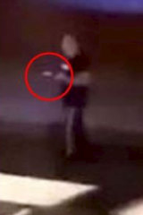 A man is seen advancing towards police in a video recorded near Penrith police station.