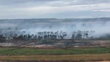 Peat in Cobrico Swamp burns on Saturday, emitting thick plumes of hazardous smoke.
