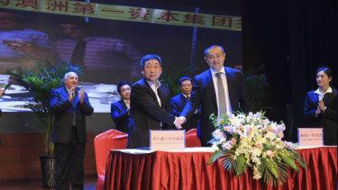 Vince Badalati, applauding at rear left, at the Tangshan ceremony in China.