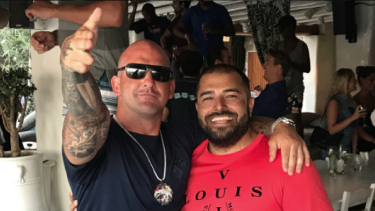 Ali Bazzi (right) with Comanchero boss Mark Buddle in the Mediterranean. Buddle tasked Bazzi with taking charge of the gang in Australia.