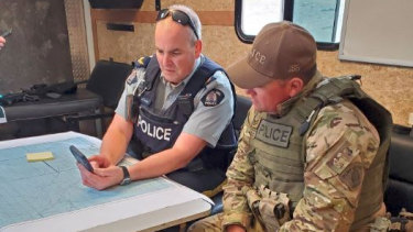 Canadian RCMP members plot out a course in the Gillam area of Manitoba.