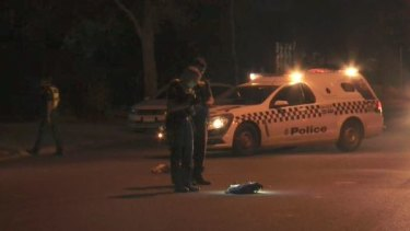 Police inspecting items left on the road after they were called to reports of an injured man on East Derrimut Crescent.