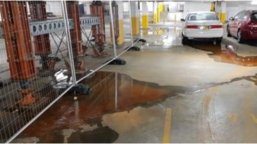 Water continues to seep into the building's car park.