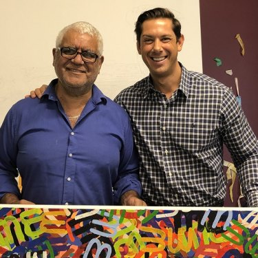 IndigiLedger founder Adam Robinson (right) withartist Richard Bell in his studio.