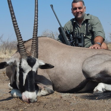 Australian property developer Nick Haridemos with an oryx.