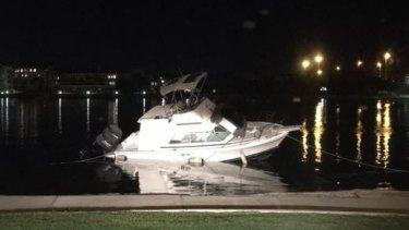 The boat has been beached on the shore of the Swan River in Fremantle near the Leftbank pub.