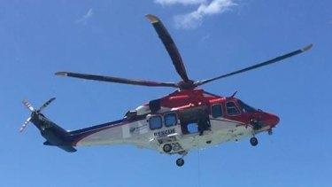 A Rescue 510 helicopter conducted sweeps of the area where the man disappeared in far north Queensland.
