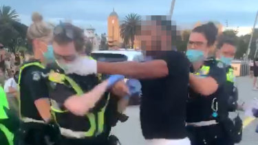 A man was arrested by police on the St Kilda beach foreshore on Saturday evening.