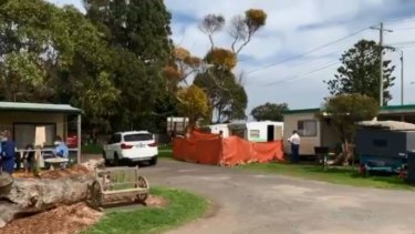 Homicide detectives and forensic specialists are combing the scene of a suspected murder at a Port Fairy caravan park.