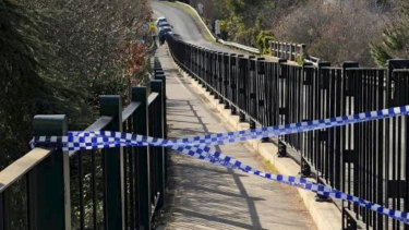 Police tape blocks Daylesford Lake, where a body was discovered on Monday.