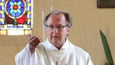 Wollongong priest Father Ron Peters has been charged over alleged historical indecent assaults in Sydney's west.