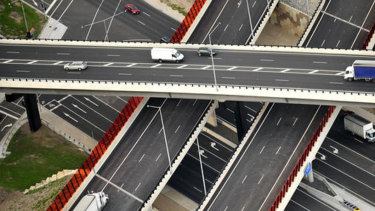 Transurban's half-year earnings jumped 10 per cent to $1 billion.