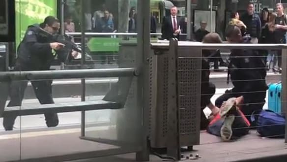 Dramatic arrest in Melbourne after man threatens to shoot tram passengers