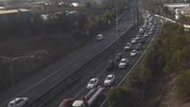 A traffic camera shows the northbound congestion on the Centenary Motorway in Darra about 7am.