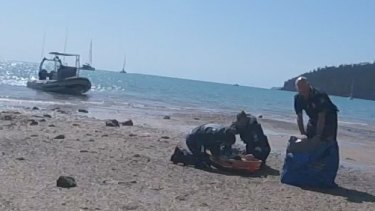 The girl was brought to a beach near Cid Harbour by the water police and loaded onto the RACQ CQ Rescue helicopter.