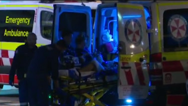 Jordan Byrne is treated by paramedics at the scene on Saturday night.