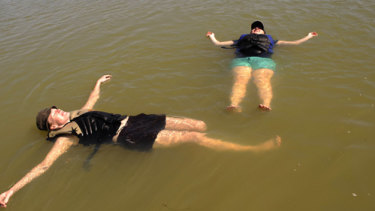 This is how they escape the heat in the north. Roanna Cranstourn and Robyn Haig in the Murray River at Mildura.
