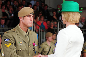 Decorated ... Ben Roberts-Smith being awarded the Victoria Cross by the then Governor-General, Quentin Bryce.