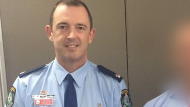 Former police commander Joel Murchie has been charged with indecent assault.