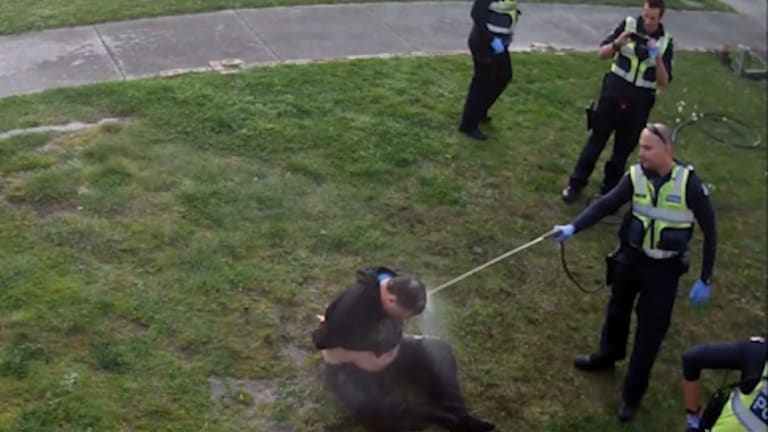 CCTV footage showed a disability pensioner being hosed by police.