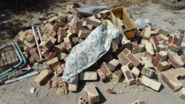 Giuseppe Napoli dumped bricks and sand waste.