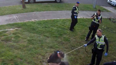 CCTV footage showed John, a disability pensioner, being hosed by police.