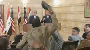 Muntazer al-Zaidi is caught on film throwing a shoe at George W. Bush.