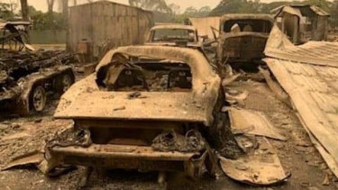 Mr Belmore's cars at his property sit burnt out after the bushfire.