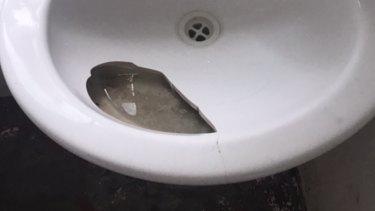 Broken sink in the bathroom.