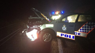 Two boys have been charged after a joyride ended when the car they were in smashed into a police car.
