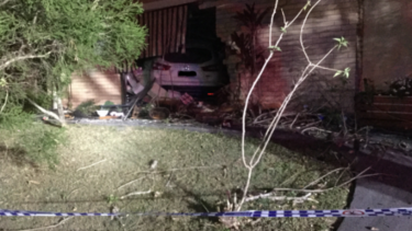 Police are appealing for information after a car crashed into a home in the Gold Coast suburb of Ashmore early on Sunday morning
