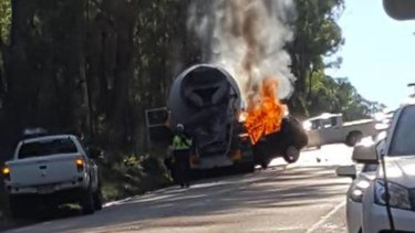 Flames engulf a car and cement truck that collided on Heathcote Road on Wednesday afternoon.