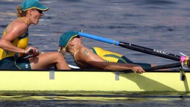 Sally Robbins lays back on boatmate Julia Wilson in Athens in 2004.