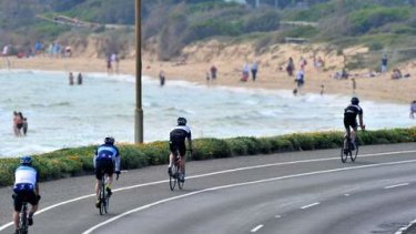 Around the Bay in a day bike ride. Cyclists approach Frankston beach.