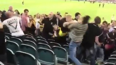 Punches are thrown during the brawl in the lower section of the Great Southern Stand.