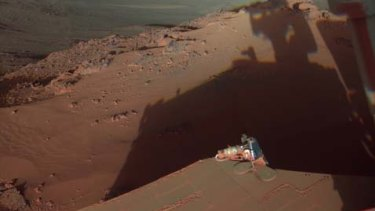 The rover Opportunity catches its own late-afternoon shadow in a view eastward across Endeavour Crater on Mars.