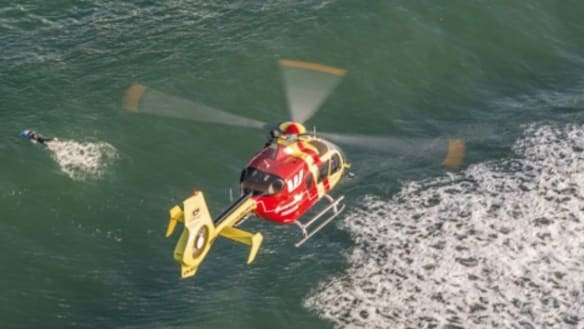 The Westpac Rescue Helicopter (pictured) and two RACQ LifeFlight Rescue helicopters are scouring waters off Double Island Point for the missingfisherman.
